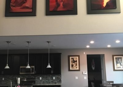 Triptychs installed on valted wall over kitchen