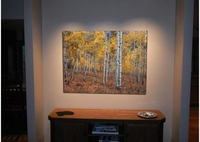 Forest artwork installed on a wall over a table