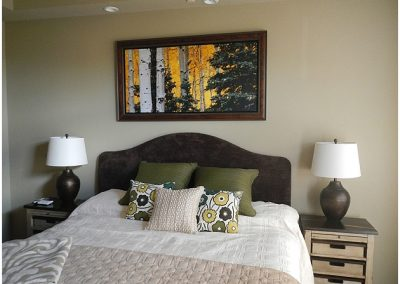 Fall forest artwork installed over a bed