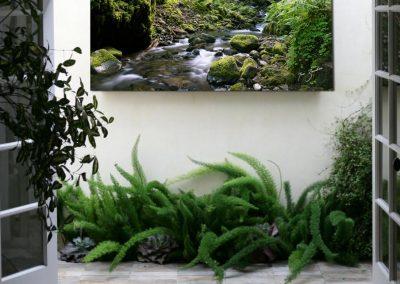 Mossy river artwork installed in breezeway
