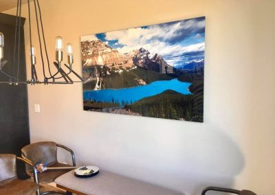 Mountain and water artwork installed over seating area
