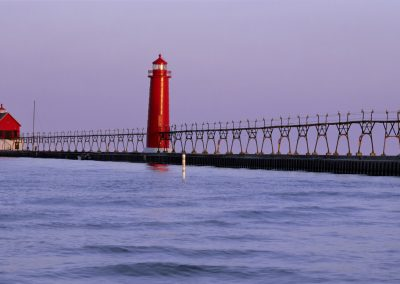 Lighthouse with bridge on the water