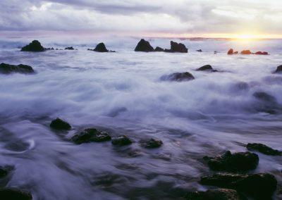 Rocky and foggy beach shoreline