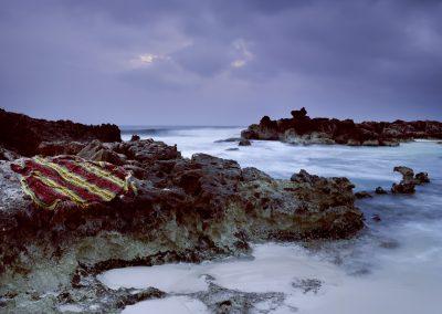 Blanket on a rocky shoreline