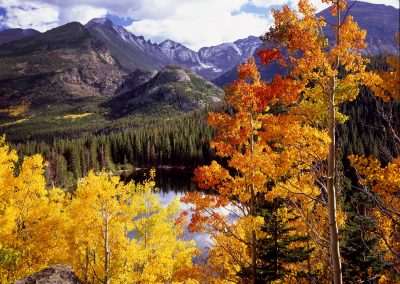Autumn leaves with river and mountain range